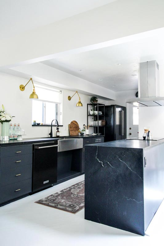 To achieve a sleek and modern look, mix shades of black and gray throughout the kitchen.